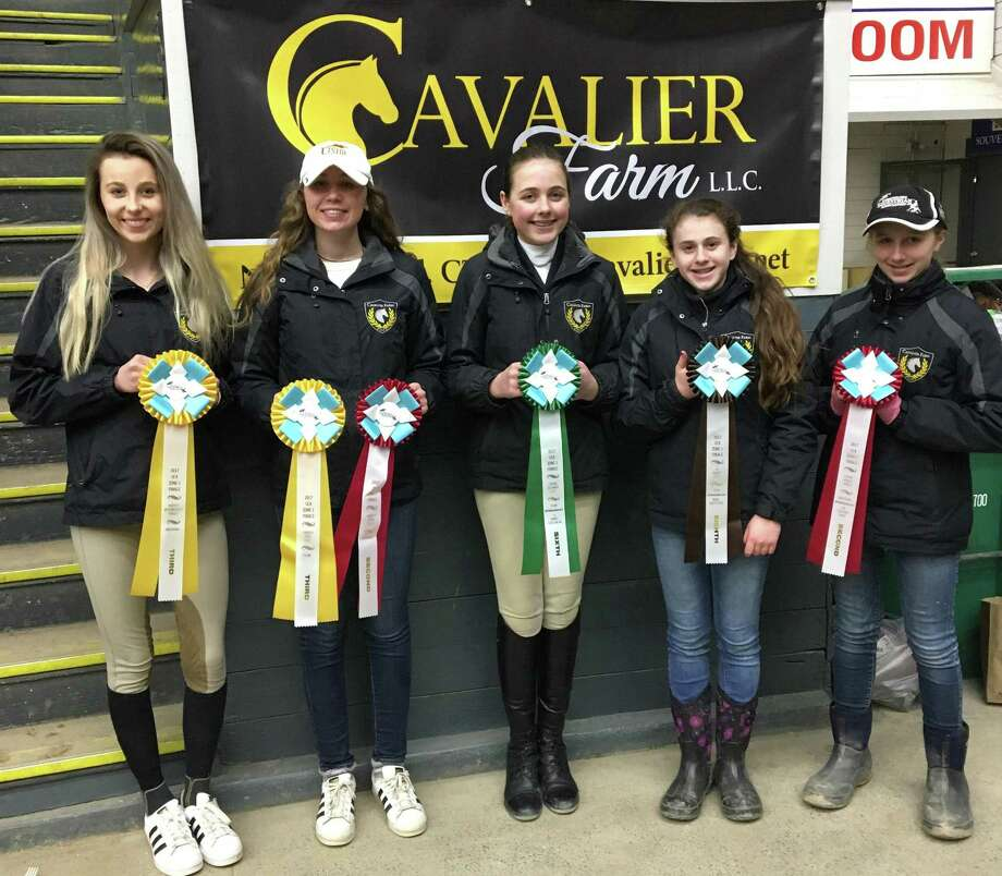 Riders on the Cavalier Farm IEA team in New Milford recently competed at Zone 1 finals at Eastern States Exposition in Springfield, Mass. The riders are, from left to right, Alycia Petrauskas, Chelsea LeMoine, Carolynn DeBellis, Madison Jennes and Devon Lemoine. Alycia, Chelsea and Devon have qualified to compete at IEA National Finals at the Virginia Horse Center in Lexington, Va., April 21-23. Photo: Courtesy Of Cavalier Farm / The News-Times Contributed