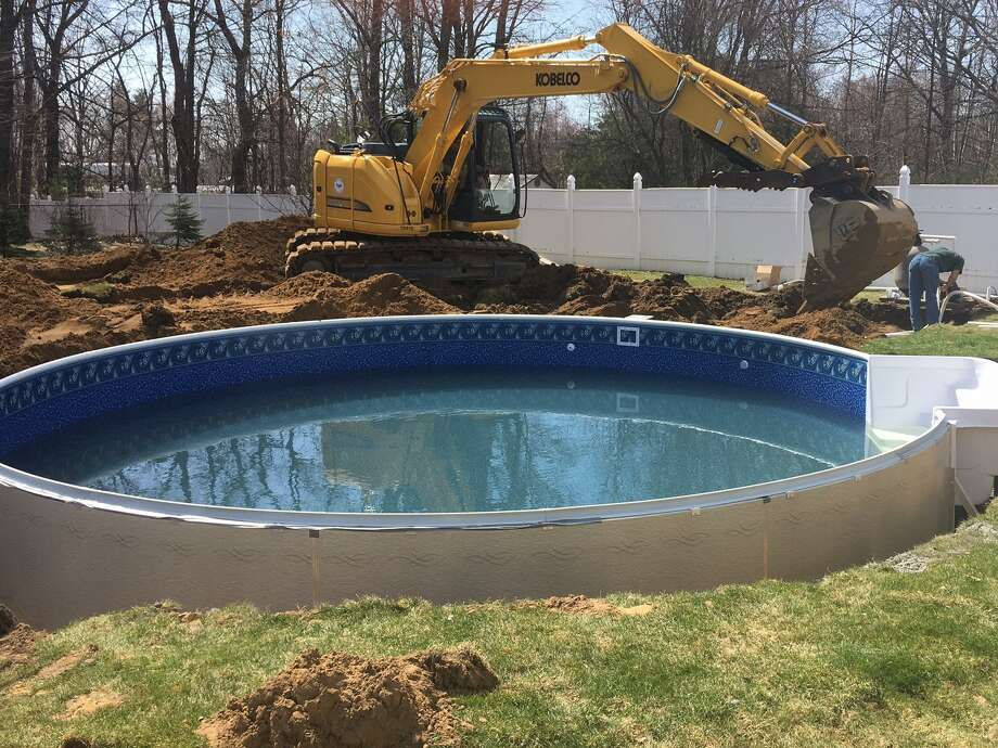 Amsterdam-based Alpin Haus has already installed its first pool of the season. Builders use heavy machinery to finish installing a 24-foot radiant pool at 7 Gabriel Way in Colonie. The project started with excavation work on Monday morning and the first phase was completed on Tuesday afternoon. (Photo provided)