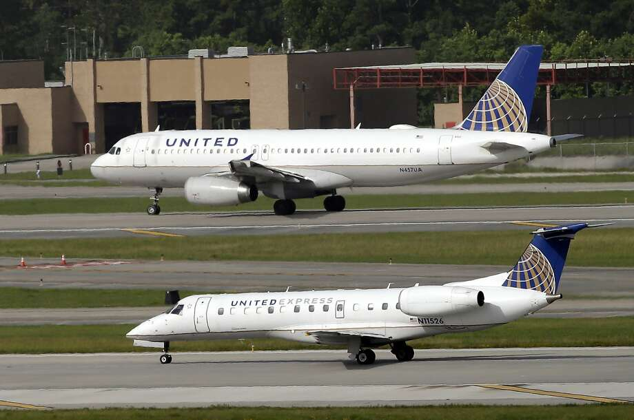 FILE - In this July 8, 2015, file photo, United Airlines and United Express planes prepare to takeoff at George Bush Intercontinental Airport in Houston. After a man is dragged off a United Express flight on Sunday, April 9, 2017, United Airlines becomes the butt of jokes online and on late-night TV. Travel and public-relations experts say United has fumbled the situation from the start, but it's impossible to know if the damage is temporary or lasting. Air travelers are drawn to the cheapest price no matter the name on the plane. (AP Photo/David J. Phillip, FIle) Photo: David J. Phillip, Associated Press