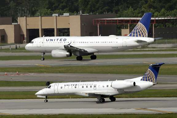FILE - In this July 8, 2015, file photo, United Airlines and United Express planes prepare to takeoff at George Bush Intercontinental Airport in Houston. After a man is dragged off a United Express flight on Sunday, April 9, 2017, United Airlines becomes the butt of jokes online and on late-night TV. Travel and public-relations experts say United has fumbled the situation from the start, but it�s impossible to know if the damage is temporary or lasting. Air travelers are drawn to the cheapest price no matter the name on the plane. (AP Photo/David J. Phillip, FIle)
