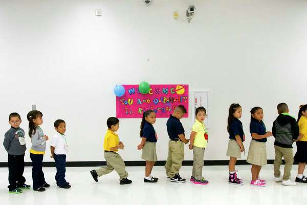 Students line up during the first day of school at Thurgood Marshall Elementary, Monday, Aug. 26, 2013, in Houston. (Cody Duty / Houston Chronicle)
