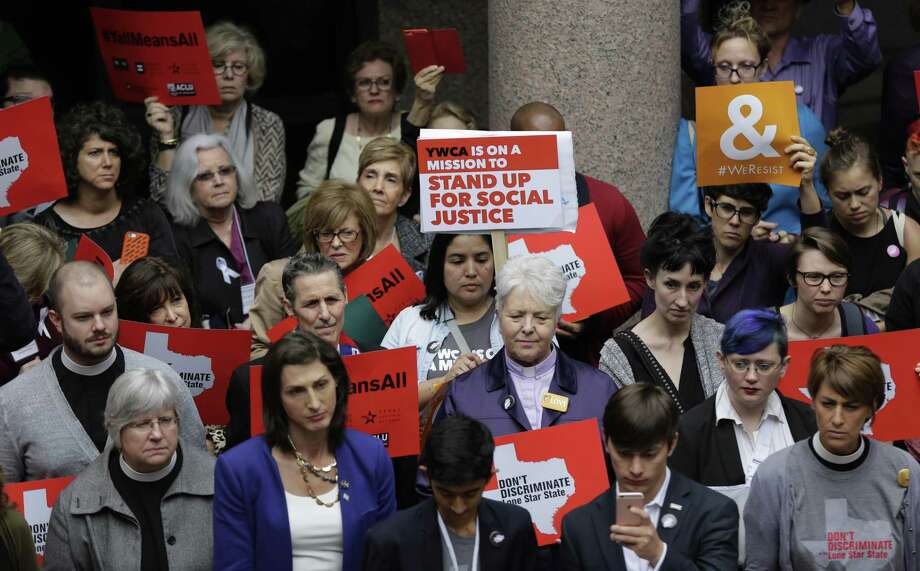 """Members of the transgender community and others who oppose Senate Bill 6 protest in the exterior rotunda at the Texas Capitol as the Senate State Affairs Committee holds hearings on the bill, Tuesday, March 7, 2017, in Austin, Texas. The transgender """"bathroom bill"""" would require people to use public bathrooms and restrooms that correspond with the sex on their birth certificate. (AP Photo/Eric Gay) Photo: Eric Gay, STF / Associated Press / Stratford Booster Club"""