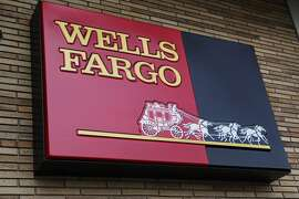 FILE - This Jan. 19, 2010, file photo, shows the exterior of a Wells Fargo Bank in Palo Alto, Calif. The career of Carrie Tolstedt, the woman blamed in a new report for a sales scandal at Wells Fargo, was until recently an inspiration for other workers wanting to make it big in the industry. Tolstedt is blamed for high pressure sales practices at the bank that spiraled out of control and resulted in millions of accounts being opened fraudulently. (AP Photo/Paul Sakuma, File)