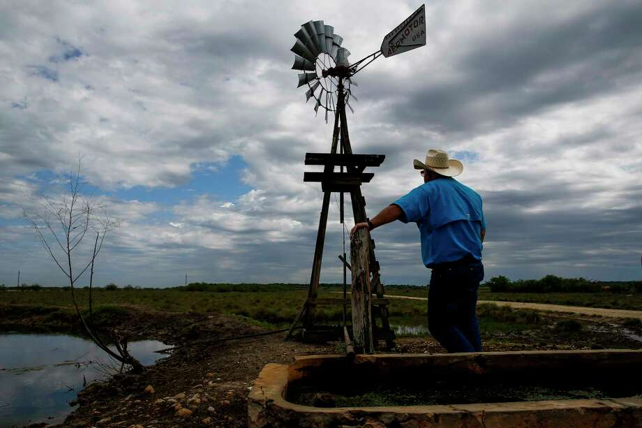 Cattle rancher Johnny Dugger looks out toward drilling rigs on the horizon as he stands near the only fresh water well on his property Wednesday, March 29, 2017 near Lolita. The environment department issued the notice of violation to Hilcorp Energy on Thursday, saying the company has violated state and federal laws by improperly controlling emissions from one of its wells in the San Juan Basin.  Photo: Michael Ciaglo, Staff / Michael Ciaglo
