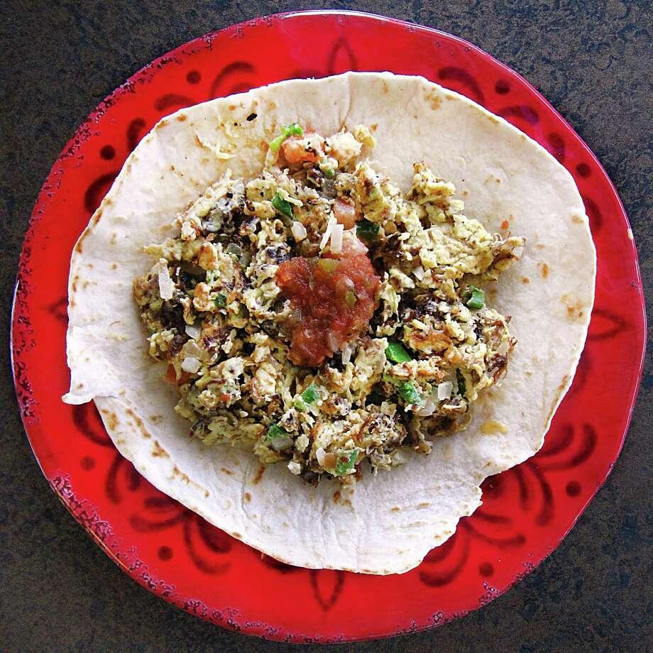 Machacado taco with scrambled eggs and pico de gallo on a handmade flour tortilla from Regio Cafe on McCullough Avenue. Photo: Mike Sutter /San Antonio Express-News