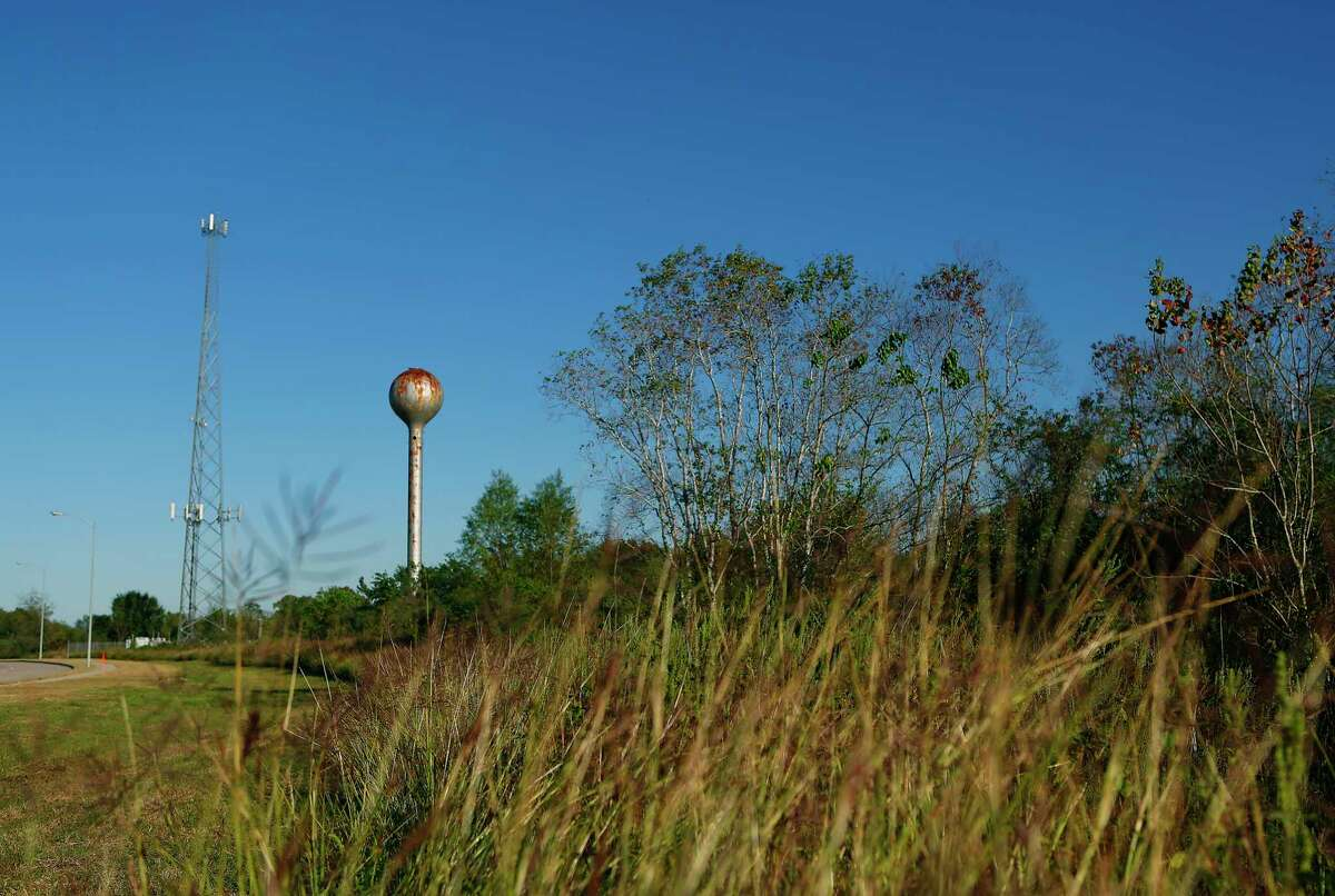 Two structures on adjoining property along Willowbend Boulevard tower above 332 acre plot of land in southwest Houston where the University of Texas plans to build a research facility, Thursday, Nov. 19, 2015. ( Mark Mulligan / Houston Chronicle )