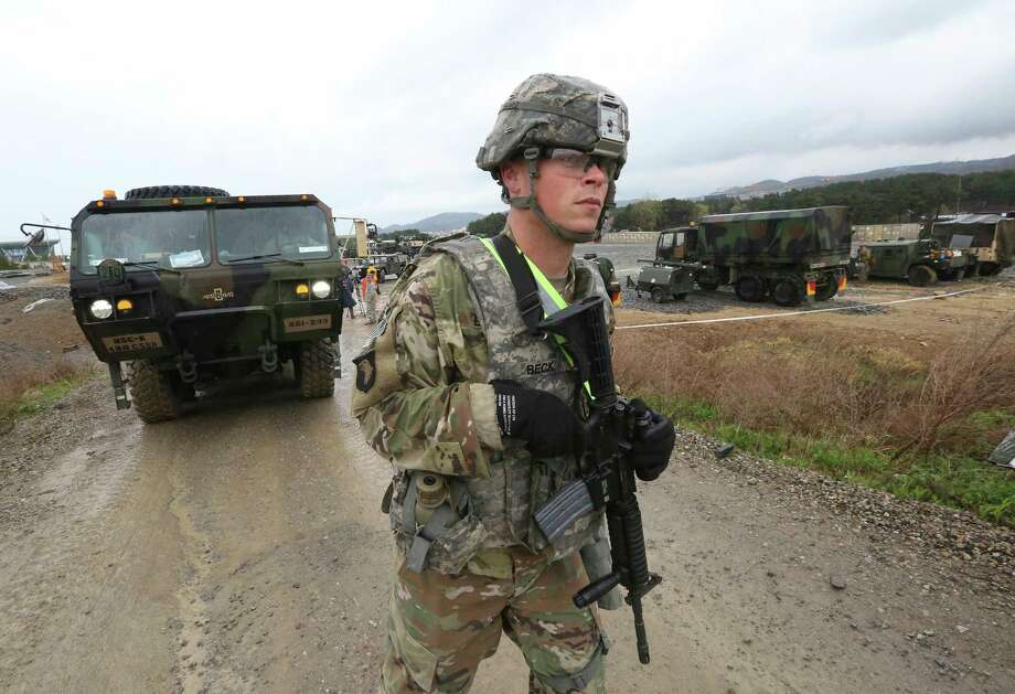 A U.S. Marine soldier conducts the U.S.-South Korea joint Exercise Operation Pacific Reach in Pohang, South Korea, Tuesday, April 11, 2017. North Korea is vowing tough counteraction to any military moves that might follow the U.S. move to send the USS Carl Vinson aircraft carrier and its battle group to waters off the Korean Peninsula. (AP Photo/Ahn Young-joon) Photo: Ahn Young-joon, STF / Copyright 2017 The Associated Press. All rights reserved.
