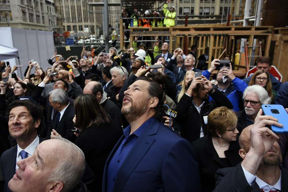 Marc Benioff, chairman and chief executive officer of Salesforce.com Inc., center, watches as the final steel beam is hoisted up during a topping off ceremony for the Salesforce Tower in San Francisco, California, U.S., on Thursday, April 6, 2017. The Salesforce Tower, officially the tallest occupiable building west of Chicago, is 61 stories high and is expected to be completed in 2017. Photographer: Michael Short/Bloomberg Photo: Michael Short, Bloomberg