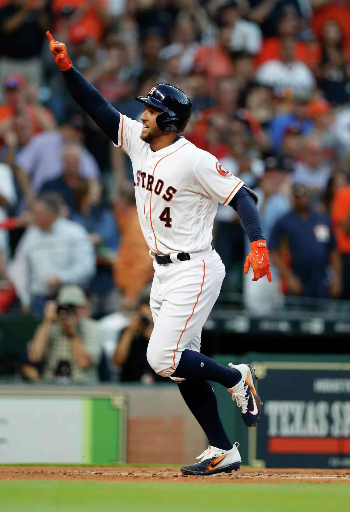 Houston Astros right fielder George Springer (4) celebrates his home run in the first inning of the Houston Astros at Minute Maid Park, Friday, March 31, 2017, in Houston. ( Karen Warren / Houston Chronicle )