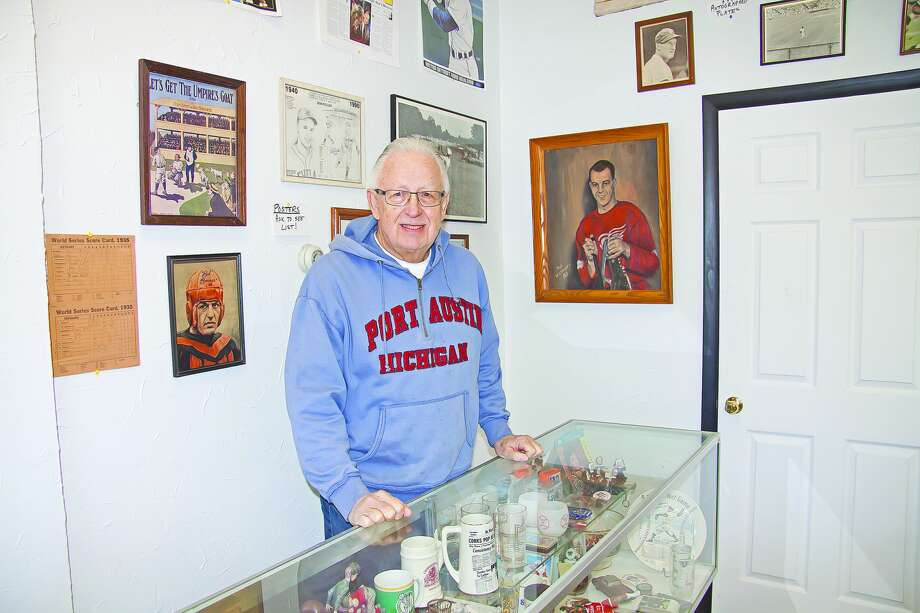 Dennis Hafeli, of Port Austin, stands behind the counter of his store, Line Drive Sports and Other Memorabilia, which contains a wide variety of collectibles.