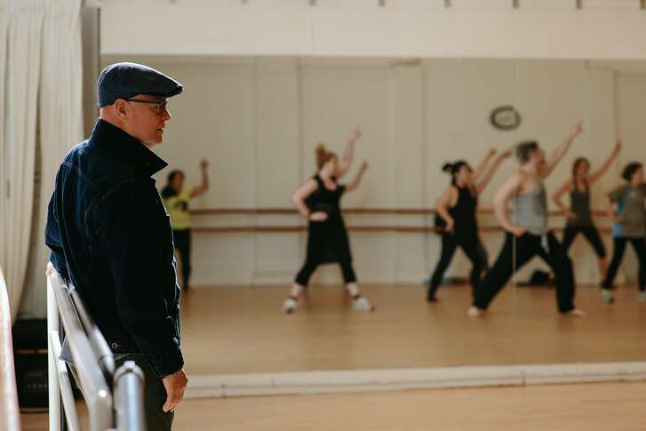 """Wayne Hazzard, Executive Director of Dancers' Group, watches a rehearsal for One Dance, the kick-off event for Bay Area Dance Week, at Alonzo King LINES Dance Center in partnership with Rhythm & Motion, in San Francisco on April 9, 2017. Dance Week, which is presented by Dancers' group, """"promotes the visibility and viability of dance."""""""