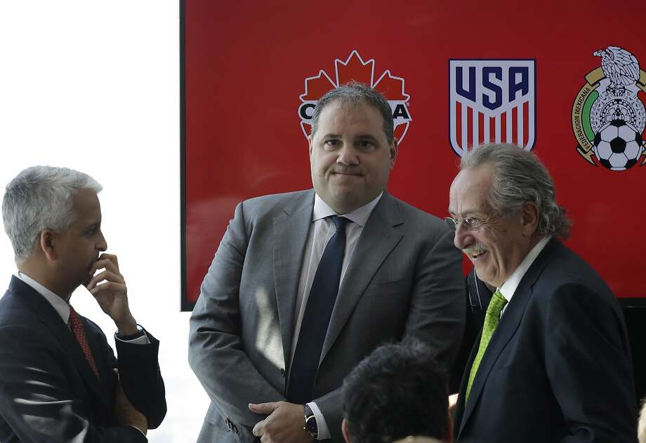 Victor Montagliani, left, President of the Canadian Soccer Association, Sunil Gulati, center, President of the United States Soccer Federation, and Decio de Maria, President of the Mexican Football Federation, arrive for a news conference, Monday, April 10, 2017, in New York. The three soccer federations announced a joint bid for the 2026 World Cup. (AP Photo/Mark Lennihan) Photo: Mark Lennihan, Associated Press