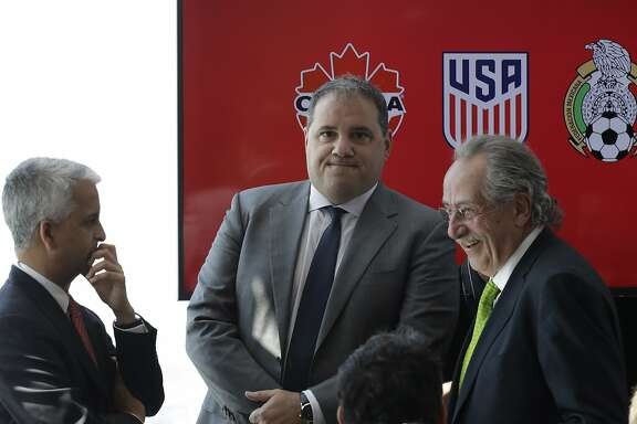 Victor Montagliani, left, President of the Canadian Soccer Association, Sunil Gulati, center, President of the United States Soccer Federation, and Decio de Maria, President of the Mexican Football Federation, arrive for a news conference, Monday, April 10, 2017, in New York. The three soccer federations announced a joint bid for the 2026 World Cup. (AP Photo/Mark Lennihan)