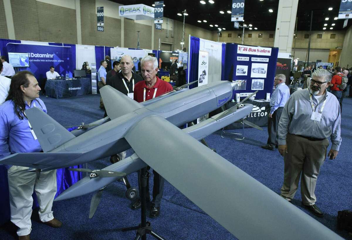 Edward De Leon, left, and Jose Alfonsin, right, of San Antonio-based DroneTechUAV, explain the features of the company's AV-2 Pelican unmanned aerial vehicle to Tony Chiarulli, second from left, and Rich Onorato during the Border Security Expo at the Henry B. Gonzalez Convention Center on Tuesday, April 11, 2017. Alfonsin said one of the company's unmanned aerial vehicles will soon be tested for use on the Navy's Stiletto stealth ships.