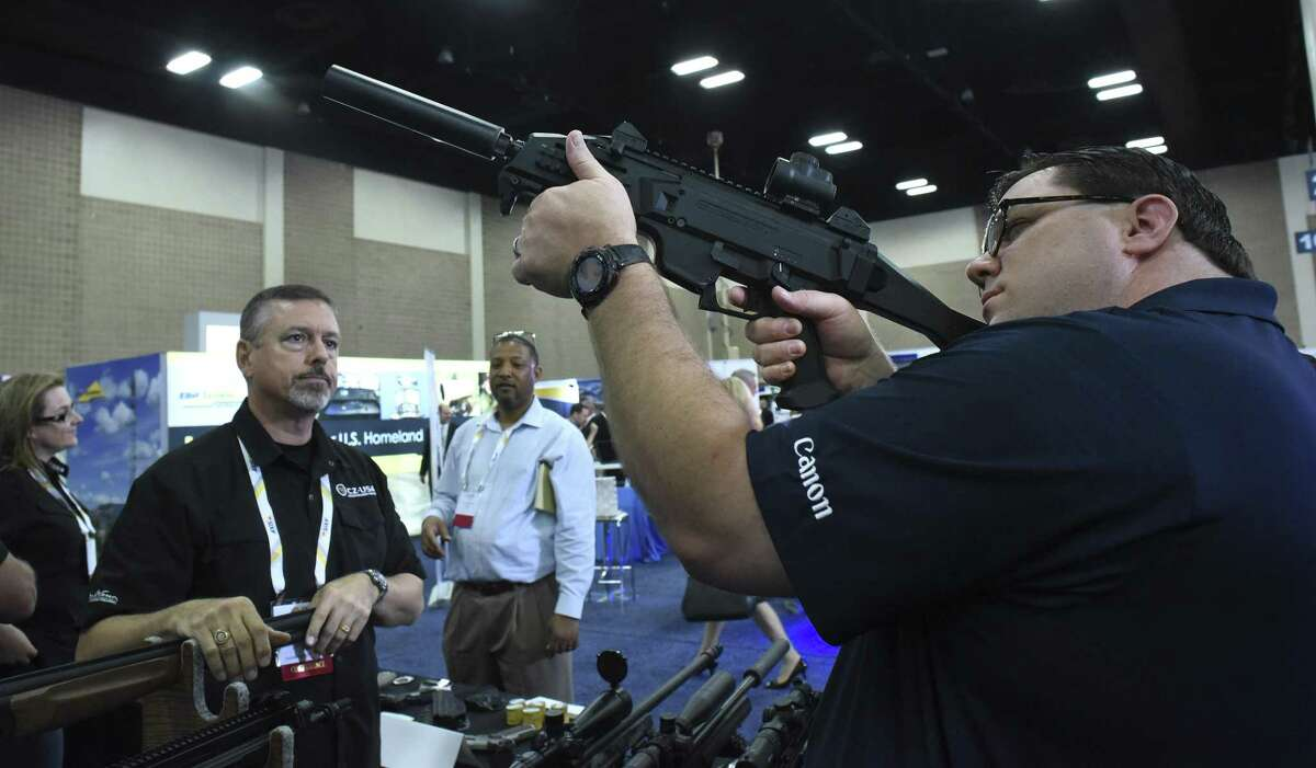 Mike Gibson tries out the Scorpion EVO 3 A1 9mm submachine gun at the CZ-USA booth during the Border Security Expo at the Convention Center.