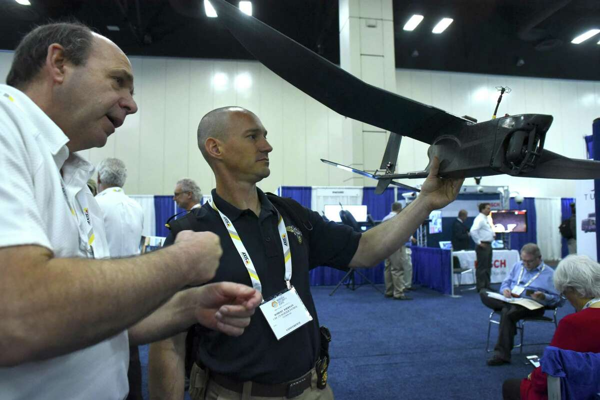 Bob Quinn, left, of vice president and division manger of ARA (Applied Research Associates), speaks with Robert Kiernan about the K-Hawk UAV during the Border Security Expo at the Henry B. Gonzalez Convention Center on Tuesday, April 11, 2017. Quinn said that the rise of the UAV hobby market has led to a revolution in military-grade systems that are available at lower prices.