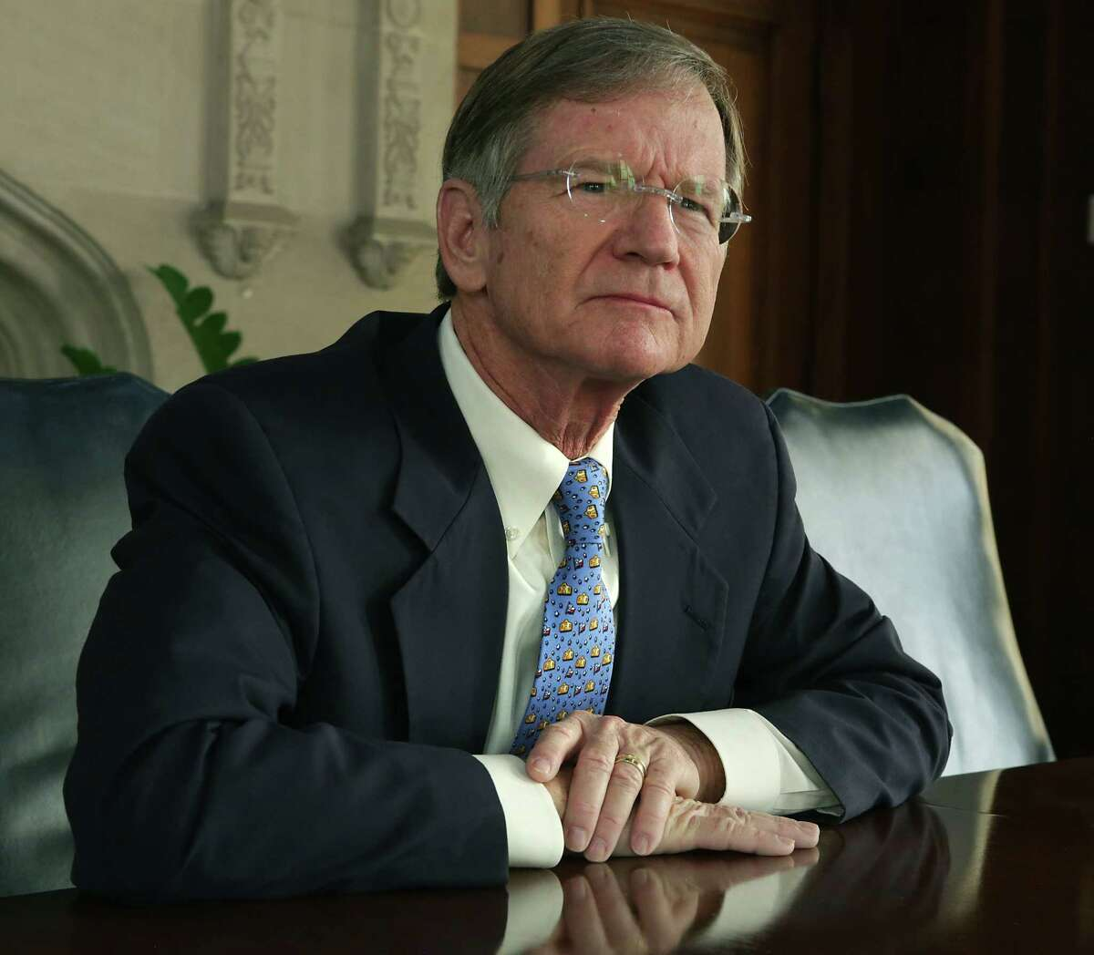 FILE - Congressman Lamar Smith speaks with members of the Express-News Editorial Board, on Oct. 13, 2016. Smith penned an essay, positing a theory that climate change may be beneficial for the economy.