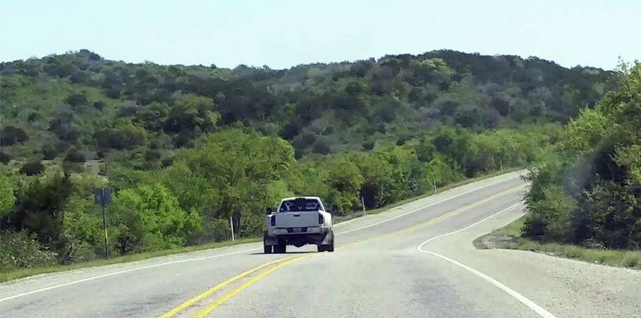 The cellphone video taken by Thania Sanchez shows Jack Young's Dodge pickup crossing both the double yellow center stripes, as well as the white line on the right of the road. Photo: Screengrab