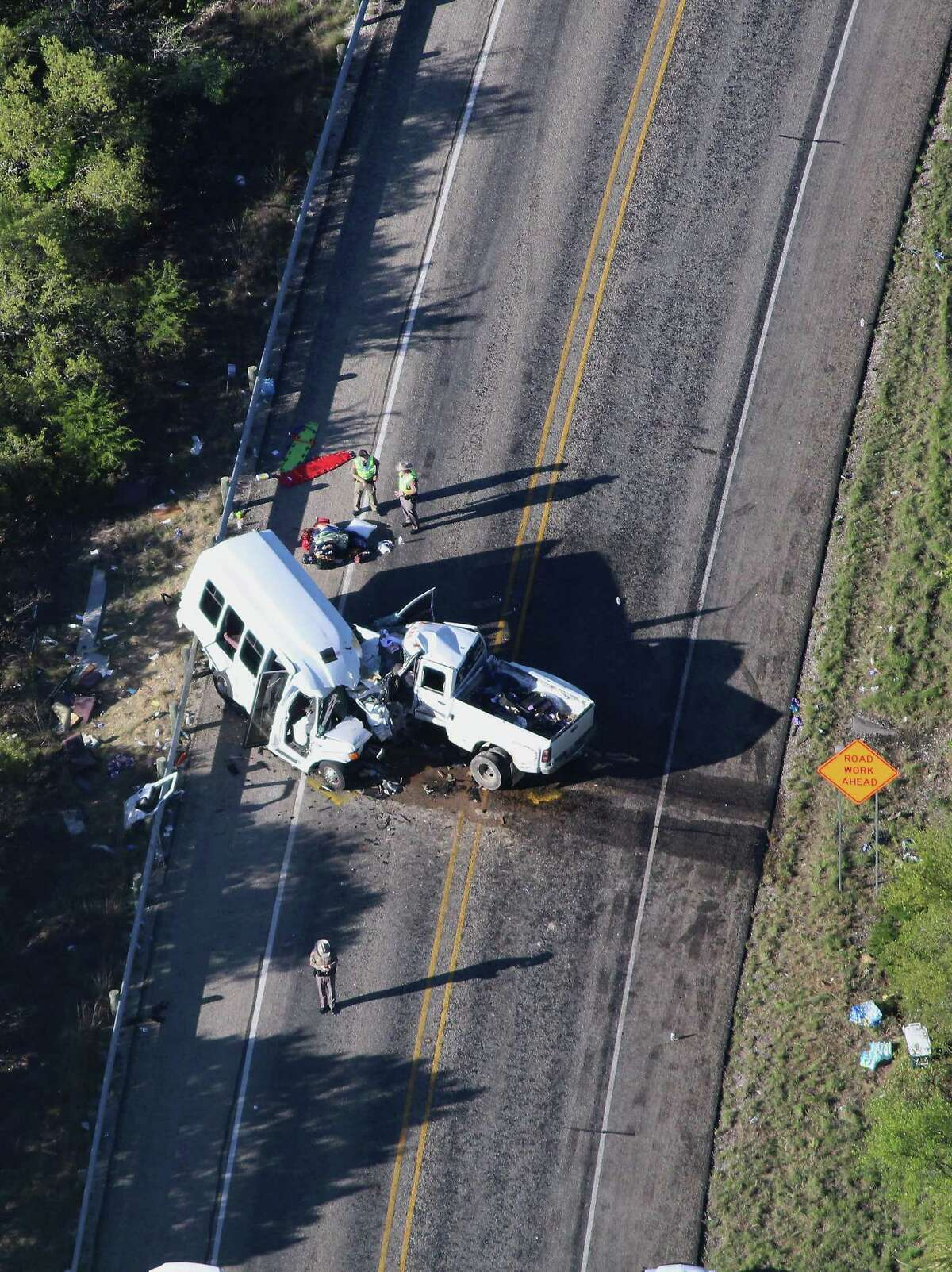 Investigators comb over the scene of an accident where 13 individuals were killed after a bus collided with a pickup truck head-on south of Garner State Park on Highway 83. The bus was carrying a group from the New Braunfels First Baptist Church who had been camping at the park. The driver of the truck, 20-year-old Jack Dillon Young, was air-lifted to a San Antonio hospital in stable condition. The NTSB is investigating the accident.