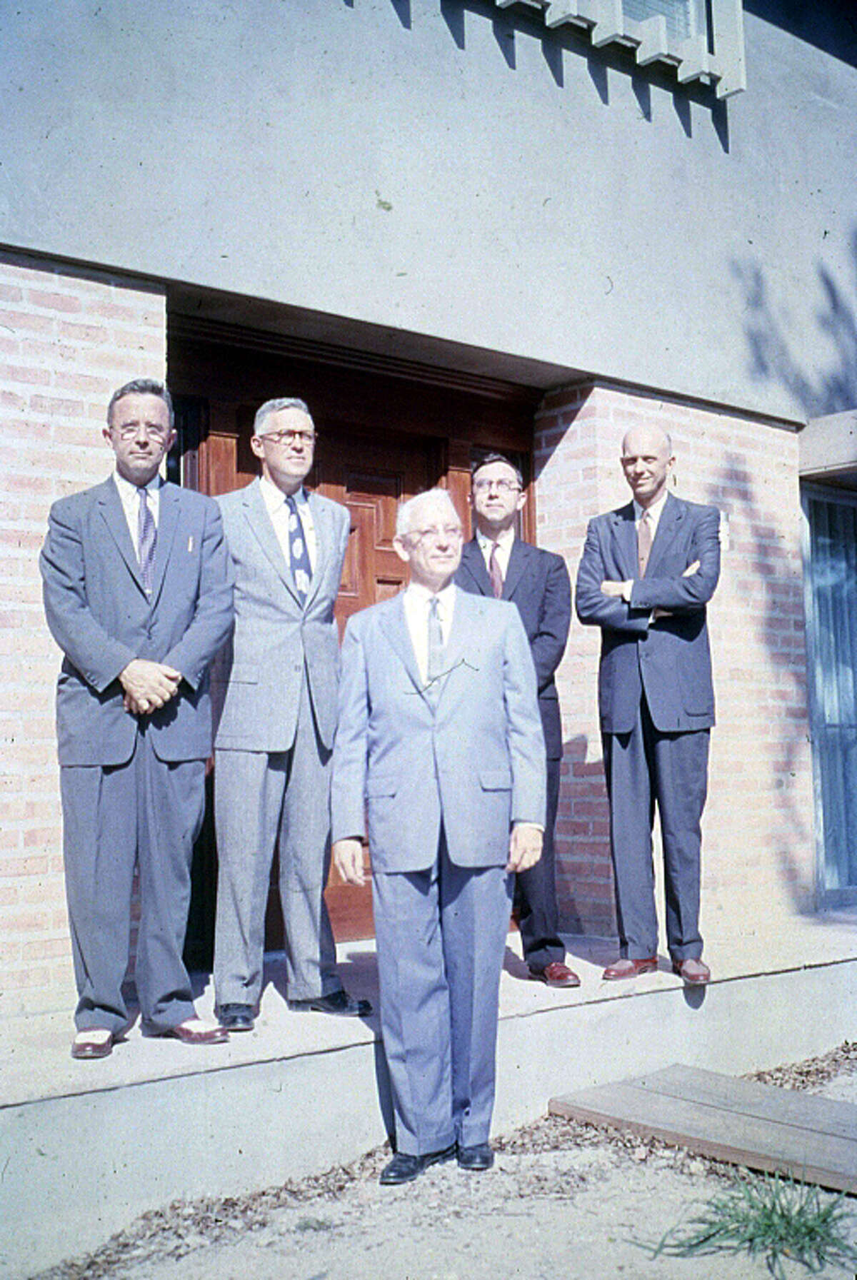 The masters of Rice's then five colleges, standing just outside the entrance to a campus building in 1957.