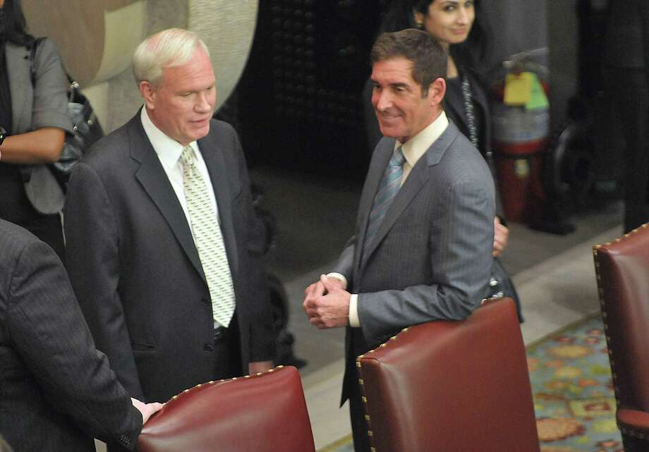 Senator Tony Avella, left, and Senator Jeff Klein talk inside the Senate Chambers near their seats on Wednesday, Feb. 26, 2014 in Albany, NY.   Senator Avella has left the main Democratic conference in favor of the breakaway Independent Democratic Conference, which Senator Klein leads.   (Paul Buckowski / Times Union) Photo: Paul Buckowski / 00025920A