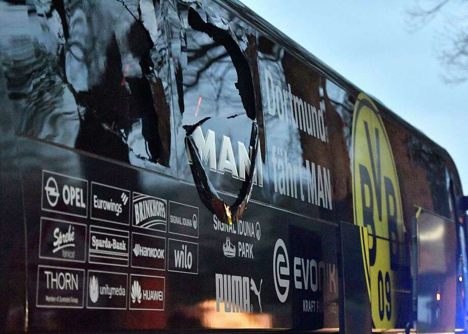 A window of Dortmund's team bus is damaged after an explosion before the Champions League quarterfinal soccer match between Borussia Dortmund and AS Monaco in Dortmund, western Germany, Tuesday, April 11, 2017.  (AP Photo/Martin Meissner) Photo: Martin Meissner, STR / AP