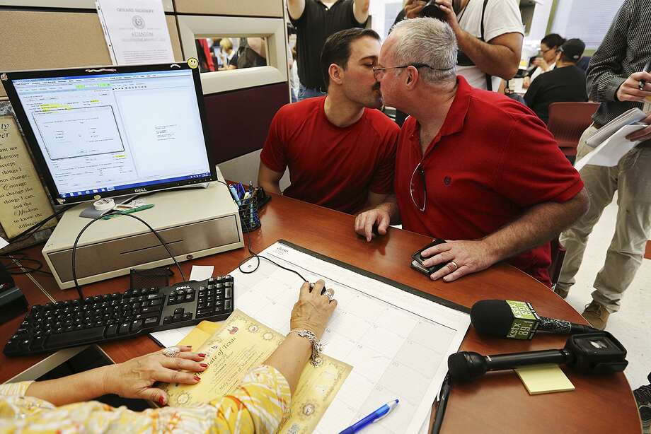 "A couple obtain a marriage license in Bexar County in 2015. The bill provides an ""alternate mechanism"" for issuing licenses. Photo: San Antonio Express-News File Photo / © 2015 San Antonio Express-News"