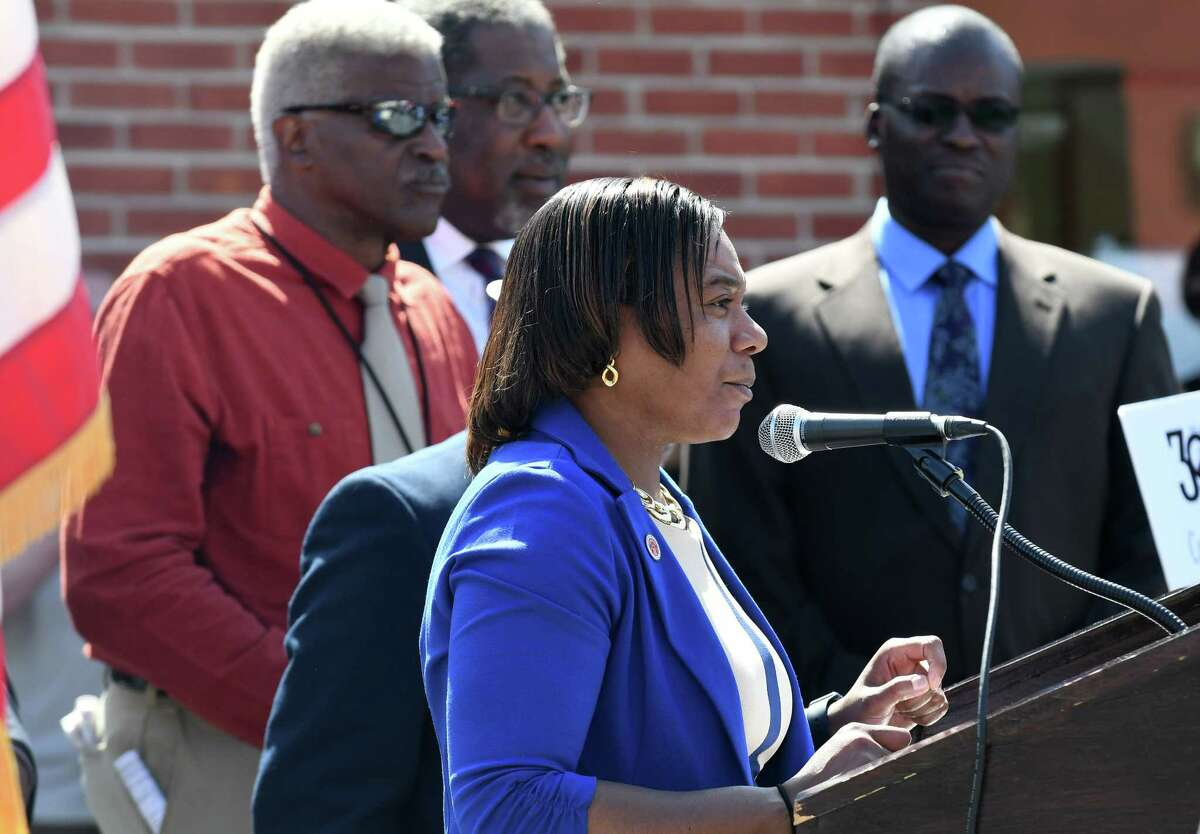 Angelicia Morris is suing Schenectady County and its Human Rights Commission to win back her job as the commission's executive director. The commission fired her in February but the lawsuit says her termination was illegal and violated the constitution. In this photo, Morris speaks during a dedication ceremony for Martin Luther King Jr. Way, a portion of Albany Street, between Veeder to Brandywine Avenues which was renamed on Tuesday, April 11, 2017, in Schenectady, N.Y. (Will Waldron/Times Union)