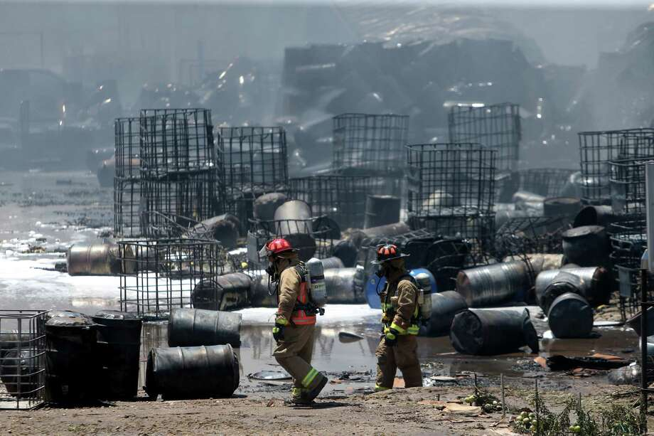 Firefighters, pictured in 2016, need an overhaul of the database containing the city's hazardous chemical locations, more training and resources in order to adequately track and prepare for fires, Fire Chief Samuel Peña said. Photo: Gary Coronado, Staff / © 2015 Houston Chronicle