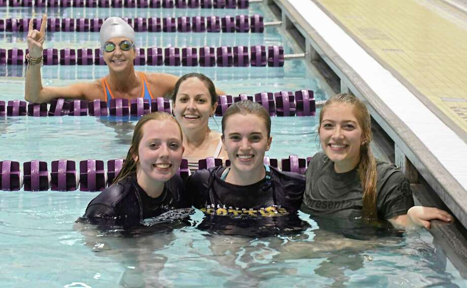 "Survivor contestant Missy Payne, far lane, swam with Ballston Spa students, from left, Kat Wright, 17, Christy Knapp, program coordinato, Abbie Laime, 18, and Miranda Blaauboer who are doing ""Survivor"" style challenges at Ballston Spa High School on Tuesday, April 11, 2017 in Ballston Spa, N.Y. The students are hoping to compete in a national ""Survivor"" style competition in Texas this summer and are doing this to help raise funds for needy teens. (Lori Van Buren / Times Union) Photo: Lori Van Buren / 20040004A"