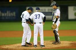 Rice University head coach Wayne Graham has a talk with pitcher Willy Amador and catcher Dominic DiCaprio during a game between the Owls and the University of Houston Cougars at Rice's Reckling Park, Tuesday, April 11, 2017, in Houston.