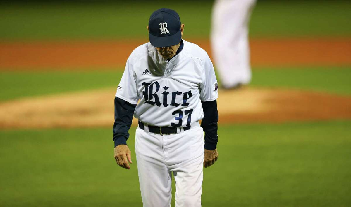 Rice University head coach Wayne Graham walks away from a talk with pitcher Willy Amador and catcher Dominic DiCaprio during a game between the Owls and the University of Houston Cougars at Rice's Reckling Park, Tuesday, April 11, 2017, in Houston.