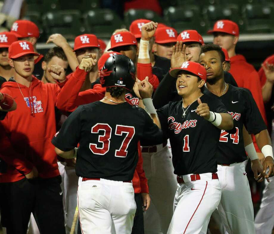 Houston's Lael Lockhart (#37) is met by his teammates after he scores tying 2-2 the game between Rice University and the University of Houston in the fifth inning at Rice's Reckling Park, Tuesday, April 11, 2017, in Houston. Photo: Mark Mulligan, Mark Mulligan / Houston Chronicle / 2017 Mark Mulligan / Houston Chronicle