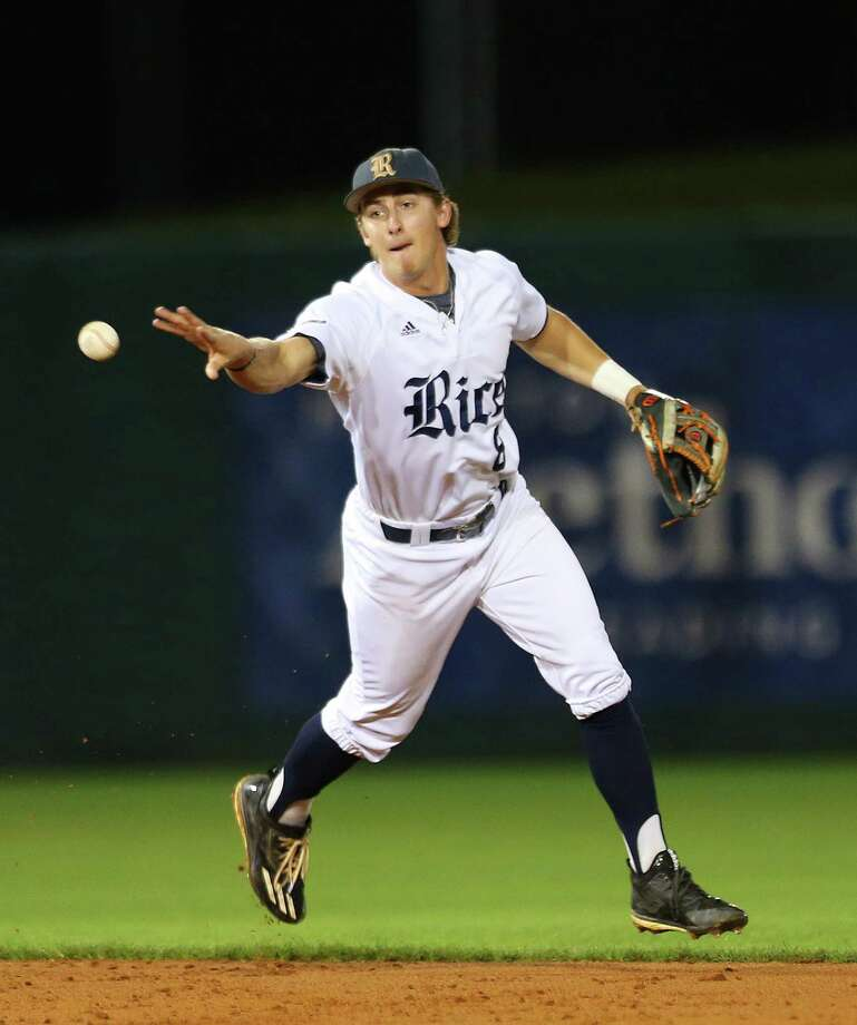 Rice short stop Ford Proctor tries to turn a double play during a game between Rice University and the University of Houston at Rice's Reckling Park, Tuesday, April 11, 2017, in Houston. Photo: Mark Mulligan, Mark Mulligan / Houston Chronicle / 2017 Mark Mulligan / Houston Chronicle
