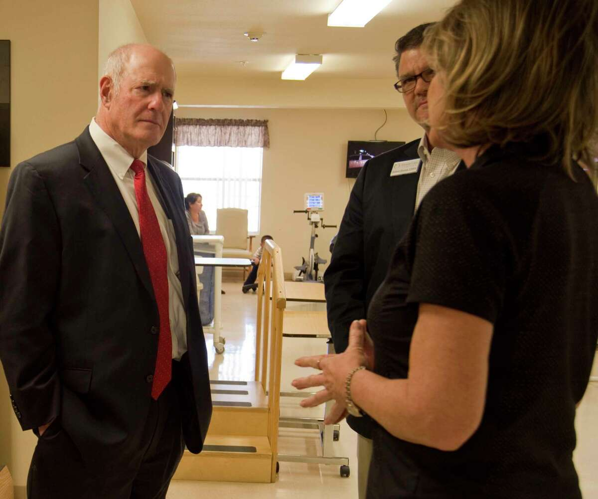State Senator Kel Seliger talks with Robert Burrus, interim administrator and Karen Wheat, director of rehabilitation with Senior Care Health and Rehabilitation Center in Midland Tuesday 03-15-16 during a tour of the facility. Tim Fischer\Reporter-Telegram
