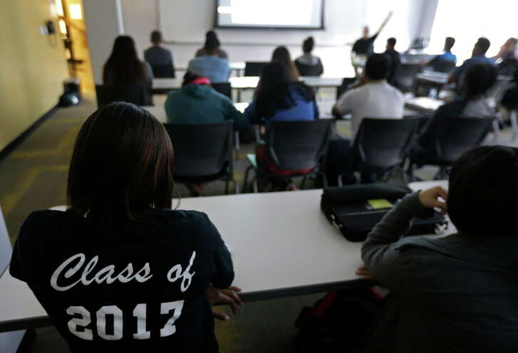 Kailyn Lollie, 17, left, wears her Class of 2017 shirt as she and other students listen during an American Government class at the Houston Community College, 1300 Holman,  Thursday, Oct. 20, 2016, in Houston. ( Melissa Phillip / Houston Chronicle )