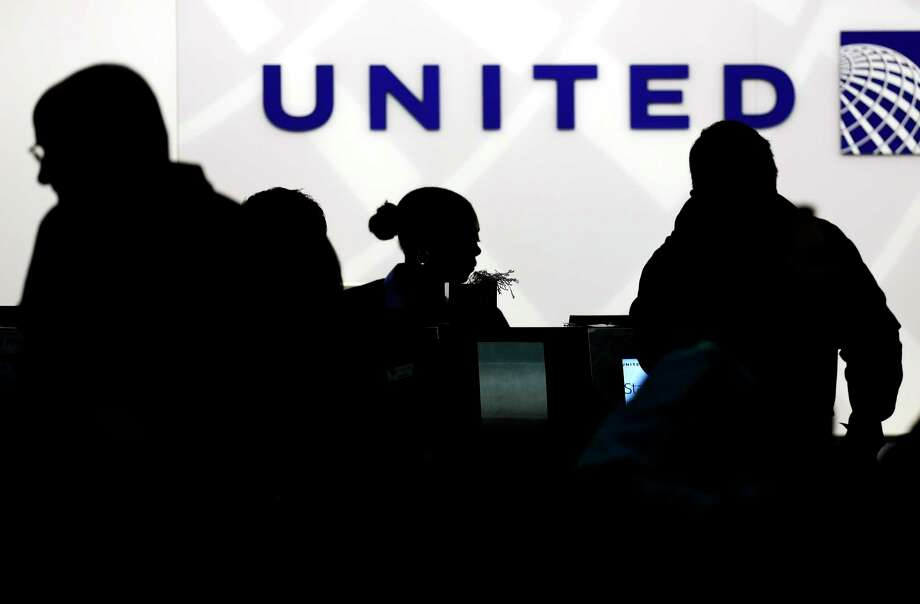 FILE - In this Saturday, Dec. 21, 2013, file photo, travelers check in at the United Airlines ticket counter at Terminal 1 in O'Hare International Airport in Chicago. After a man is dragged off a United Express flight on Sunday, April 9, 2017, United Airlines becomes the butt of jokes online and on late-night TV. Travel and public-relations experts say United has fumbled the situation from the start, but it's impossible to know if the damage is temporary or lasting. Air travelers are drawn to the cheapest price no matter the name on the plane. (AP Photo/Nam Y. Huh, File) Photo: Nam Y. Huh, STF / Copyright 2017 The Associated Press. All rights reserved.