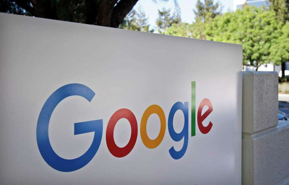 """FILE - This Oct. 20, 2015, file photo, shows a sign outside Google headquarters in Mountain View, Calif. Google says it is """"taken aback"""" by the Labor Department's claim that it does not compensate women fairly. The company says it conducts """"rigorous analyses"""" that its pay practices are gender-blind and analysts who calculate suggested pay do not have access to an employee's gender data. The company says it analyzed 52 major job categories in 2016 and found """"no gender pay gap."""" (AP Photo/Marcio Jose Sanchez, File) Photo: Marcio Jose Sanchez, STF / Copyright 2016 The Associated Press. All rights reserved. This material may not be published, broadcast, rewritten or redistribu"""