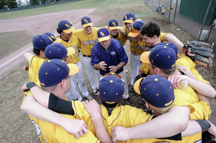 Saratoga Spa Catholic huddle up before their home game against Greenwich Tuesday April 11th, 2017. Photo By Eric Jenks Photo: Eric Jenks / Eric Jenks 2017