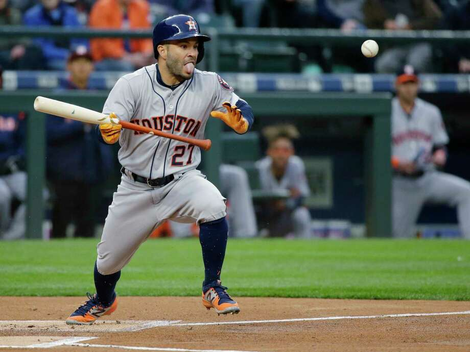 Astros second baseman Jose Altuve tries to bunt for a hit in the first inning Tuesday night, but Mariners pitcher Ariel Miranda threw him out at first. For a recap of the game, go to chron.com/astros. Photo: Ted S. Warren, STF / Copyright 2017 The Associated Press. All rights reserved.