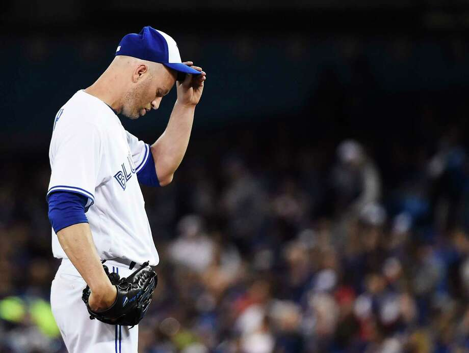 Toronto Blue Jays starting pitcher J.A. Happ reacts on the mound during the first inning of the team's baseball game against the Milwaukee Brewers in Toronto on Tuesday, April 11, 2017. (Nathan Denette/The Canadian Press via AP) ORG XMIT: NSD611 Photo: Nathan Denette / THE CANADIAN PRESS