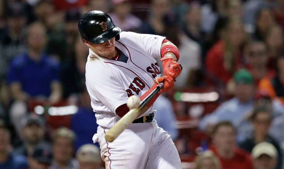 Boston Red Sox's Christian Vazquez connects for a two RBI, triple during the eighth inning of a baseball game against the Baltimore Orioles at Fenway Park in Boston, Tuesday, April 11, 2017. (AP Photo/Charles Krupa) ORG XMIT: MACK118 Photo: Charles Krupa / Copyright 2017 The Associated Press. All rights reserved.