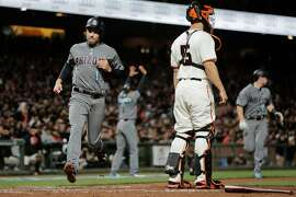 Diamondbacks player A.J Pollock makes a home run during the third inning of a game between the San Francisco Giants and the Arizona Diamondbacks at AT&T Park in San Francisco, California, on Tuesday, April 11, 2017.