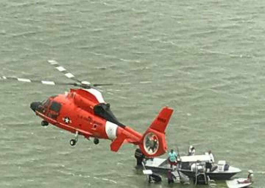 Four adults and two children were rescued after their boat capsized near Padre Island on April 11, 2017. Photo: U.S. Coast Guard