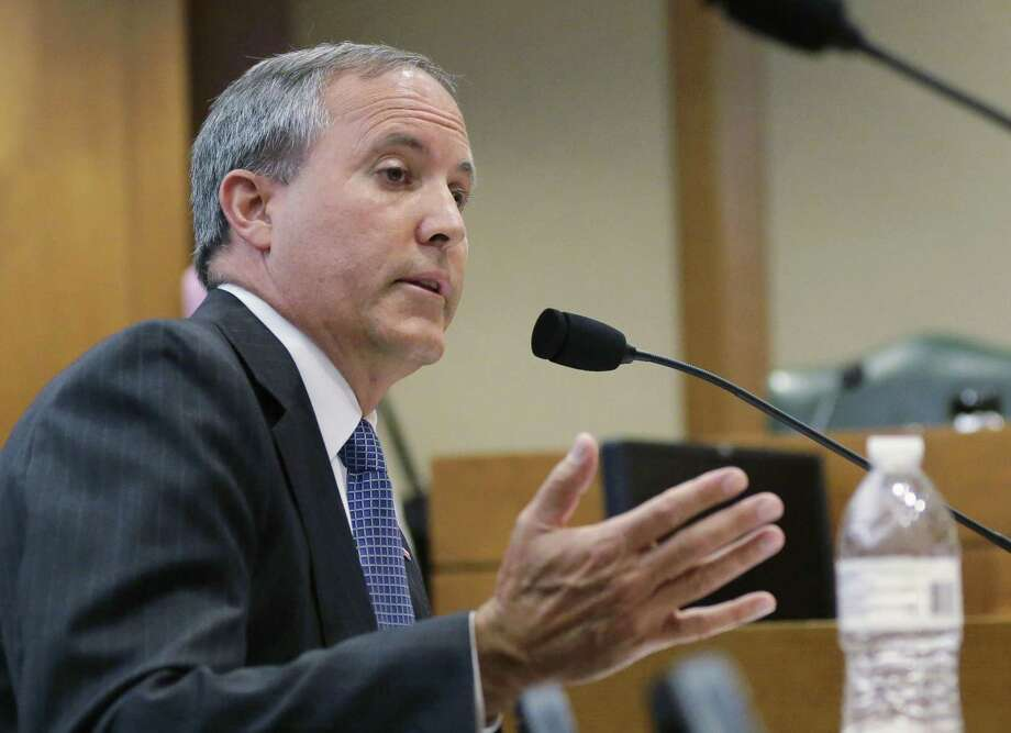 Attorney General Ken Paxton won't face trial on a trio of criminal felony charges until next year, possibly right after the primary election, a Harris County district judge ruled Wednesday. Photo: Associated Press File Photo / Stratford Booster Club