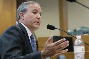 Texas Attorney General Ken Paxton speaks during a hearing in Austin on July 29, 2015. On the brink of bringing Paxton to trial on felony securities fraud charges, the government's prosecutors are threatening to bail out of the case unless they get paid. Paxton, a stockbroker and state lawmaker before being elected attorney general two years ago, was indicted for allegedly steering investors to a technology startup in 2011 without disclosing that he was being paid by the company. The trial is scheduled to start May 1, 2017.