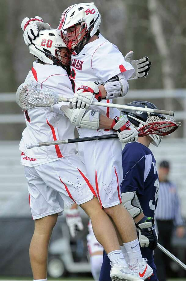 New Canaan's Quintin O'Connell celebrates with his brother Ryan O'Connell after Ryan scored in the first half against Wilton on Wednesday at Dunning Field. Photo: Matthew Brown / Hearst Connecticut Media / Stamford Advocate