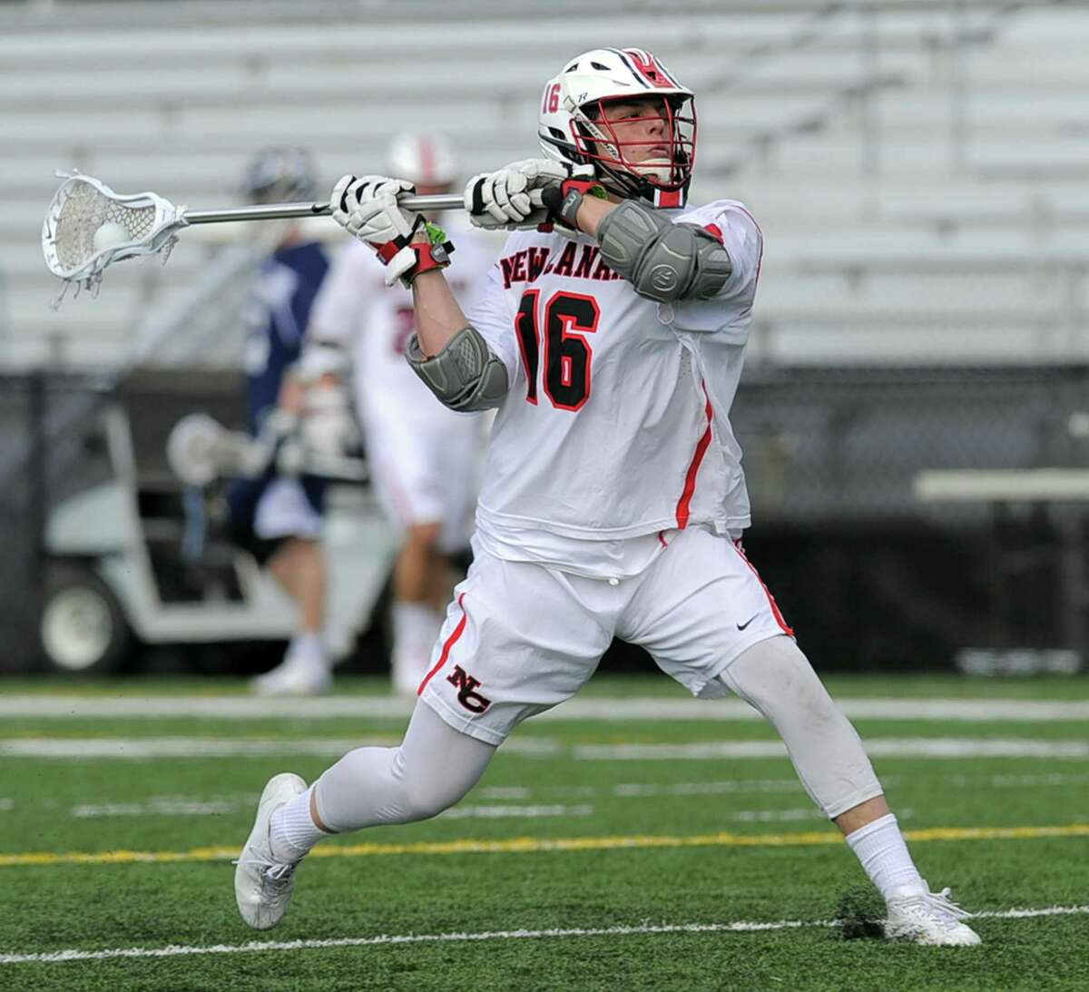New Canaan's Graham Braden fires a shot against Wilton on Wednesday. Braden scored the game-winner with 11 seconds remaining.