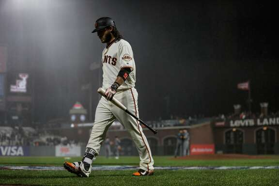 Brandon Crawford walks back to the dugout after striking out during the bottom of the 9th inning of a game between the San Francisco Giants and the Arizona Diamondbacks at AT&T Park in San Francisco, California, on Tuesday, April 11, 2017.