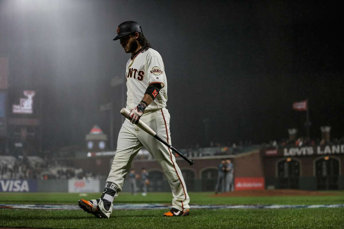 Brandon Crawford walks back to the dugout after striking out during the bottom of the 9th inning of a game between the San Francisco Giants and the Arizona Diamondbacks at AT&T Park on April 11, 2017.